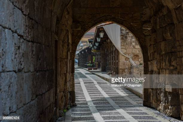 archway entrance to souk, byblos, jbail, lebanon - lebanon stock photos and pictures