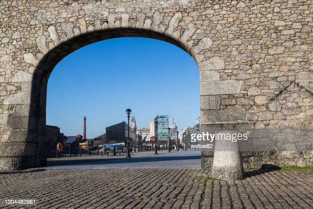archway to the liverpool waterfront - liverpool england stock pictures, royalty-free photos & images