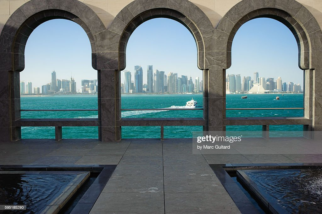 Archways Framing The Persian Gulf And Dohas Skyline At The Museum Of ...