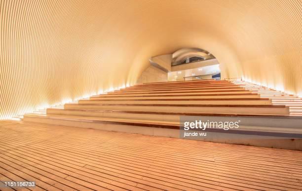 arc-shaped interior space and staircases ascending step by step. - arc élément architectural photos et images de collection