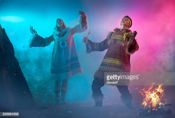 arctic dancing couple - inuit stock pictures, royalty-free photos & images