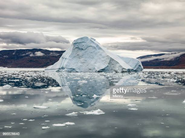 arctic iceberg reflections ilulissat greenland - berg stock pictures, royalty-free photos & images