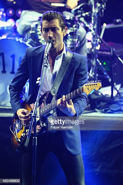 Arctic Monkeys' Alex Turner perform at Clear Channel Presents iHeart Live Series With Artic Monkeys at iHeartRadio Theater on June 11 2014 in Burbank...
