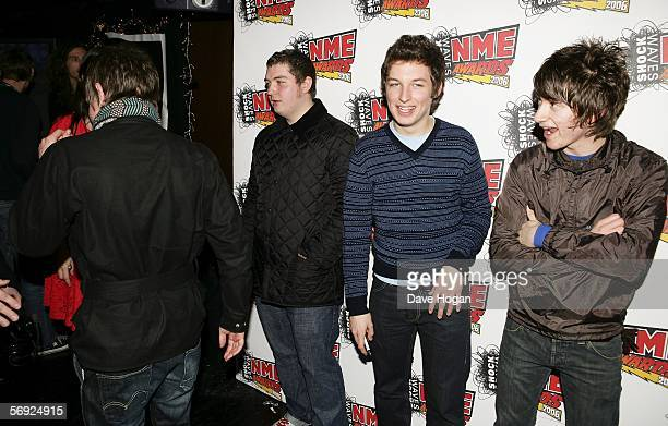 Arctic Monkeys Jamie Cook Andy Nicholson Matt Helders and Alex Turner pose in the Awards Room at the Shockwaves NME Awards 2006 the weekly music...