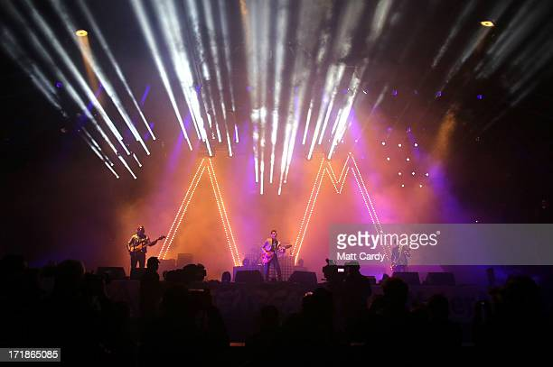 Arctic Monkeys lead singer Alex Turner performs on the Pyramid Stage at the Glastonbury Festival of Contemporary Performing Arts site at Worthy Farm...