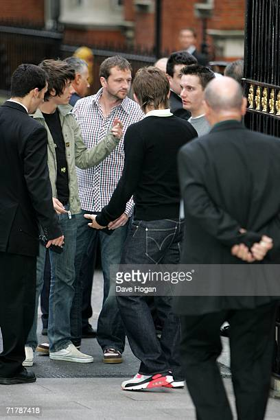 Arctic Monkeys members Alex Turner Andy Nicholson and Jamie Cook are directed by security as they arrive on foot at the annual Nationwide Mercury...