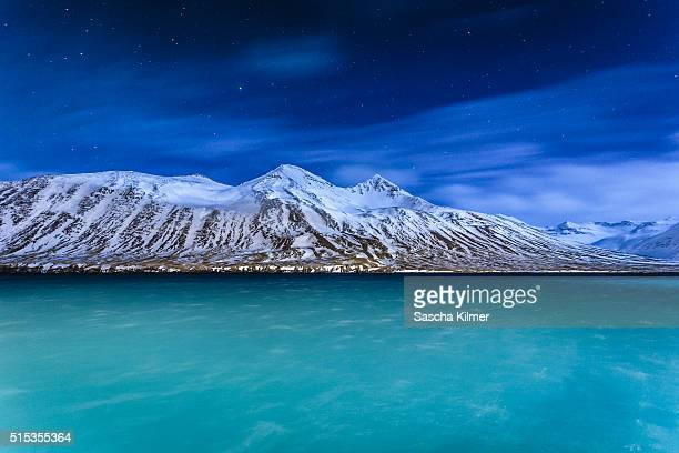 Arctic Night with illuminated mountains and fjord