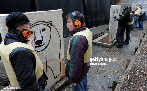 Arctic reasearchers analyses their hit rate on polar bear shaped targets at a shooting range in Altenwalde Germany 28 January 2016 Scientists of the...
