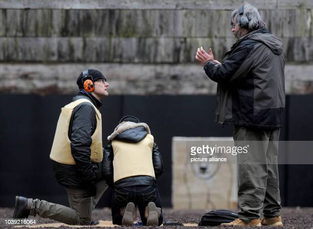 Arctic reasearchers are instructed by a shooting instructor at a shooting range in Altenwalde Germany 28 January 2016 Scientists of the German...