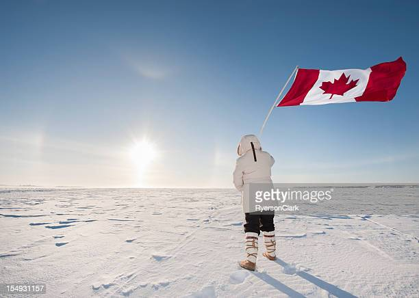 arctic sundog or parhelion, woman and canadian flag. - north stock pictures, royalty-free photos & images