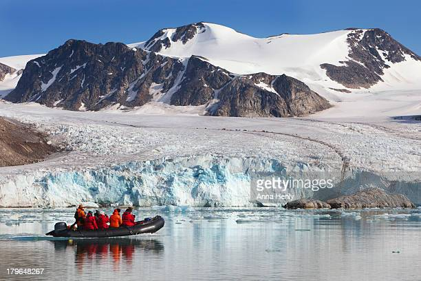 arctic tourists cruising glacier in svalbard - spitsbergen stock pictures, royalty-free photos & images