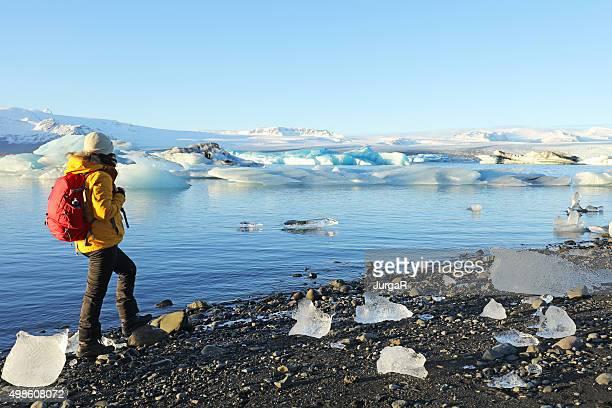 Arctic Traveller Standing at Jokulsarlon Glacial Lagoon in Iceland