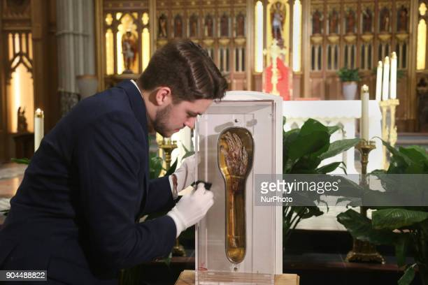 D'Arcy Murphy the Guardian for the St Francis Xavier relic during its time in Canada cleans the relic case during public veneration at St Michaels...