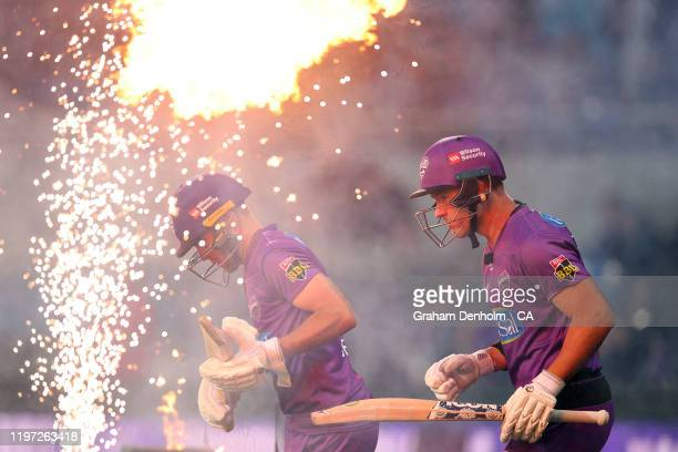 Arcy Short and Caleb Jewell of the Hurricanes run out to bat during the Big Bash League match between the Hobart Hurricanes and the Brisbane Heat at...