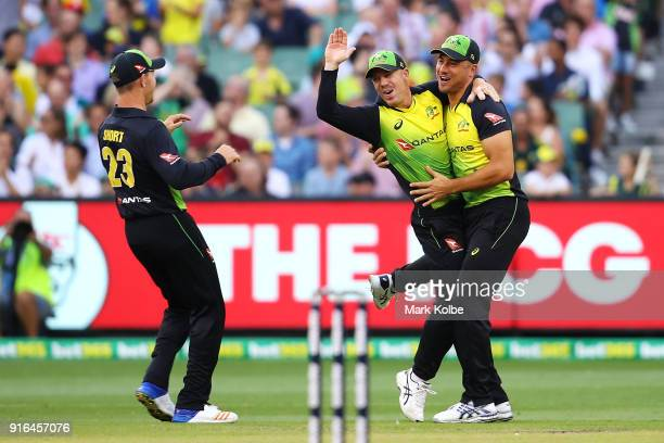 Arcy Short David Warner and Marcus Stoinis of Australia celebrate Warner running out Dawid Malan of England during game two of the International...