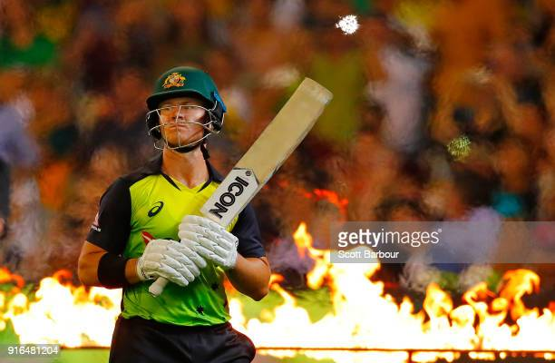 Arcy Short of Australia walks onto the field to bat through flames during game two of the International Twenty20 series between Australia and England...