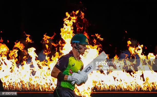 Arcy Short of Australia walks out to bat through flames during the Twenty20 International match between Australia and England at Blundstone Arena on...