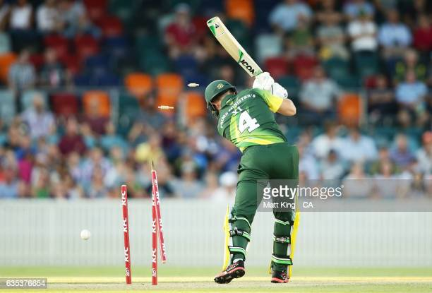 Arcy Short of the Australian PMXI is bowled by Lasith Malinga of Sri Lanka during the T20 warm up match between the Australian PM's XI and Sri Lanka...