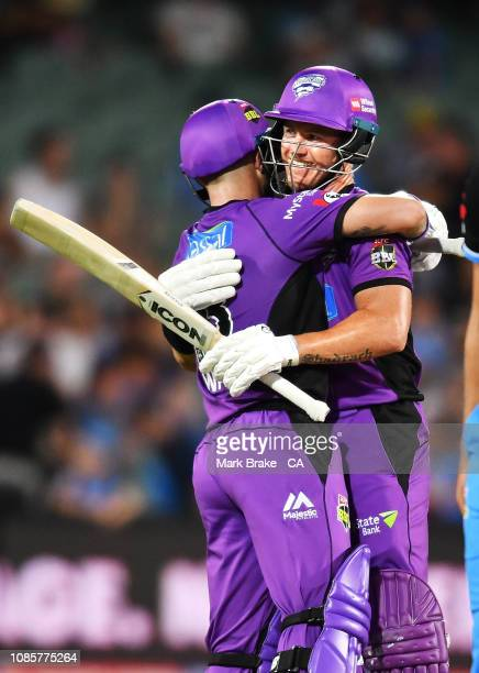 Arcy Short of the Hobart Hurricanes and Matthew Wade of the Hobart Hurricanes hug after they hit the winning run during the Big Bash League match...