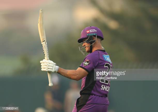 D'arcy Short of the Hobart Hurricanes celebrates after scoring his fifty runs during the Big Bash League match between the Hobart Hurricanes and the...