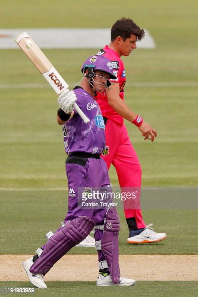 Arcy Short of the Hobart Hurricanes raises his bat after scoring 50 runs during the Big Bash League match between the Hobart Hurricanes and the...