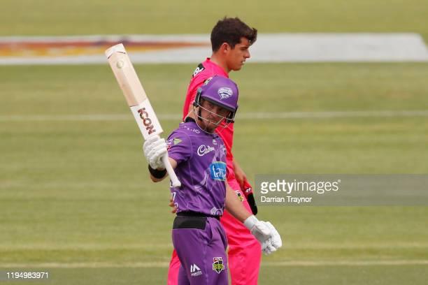 Arcy Short of the Hobart Hurricanes raises his bat after scoring 50 runs during the Big Bash League match between the Hobart Hurricanes and the...