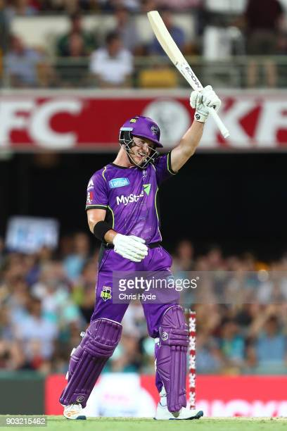 Arcy Short of the Hurricanes celebrates his century during the Big Bash League match between the Brisbane Heat and the Hobart Hurricanes at The Gabba...