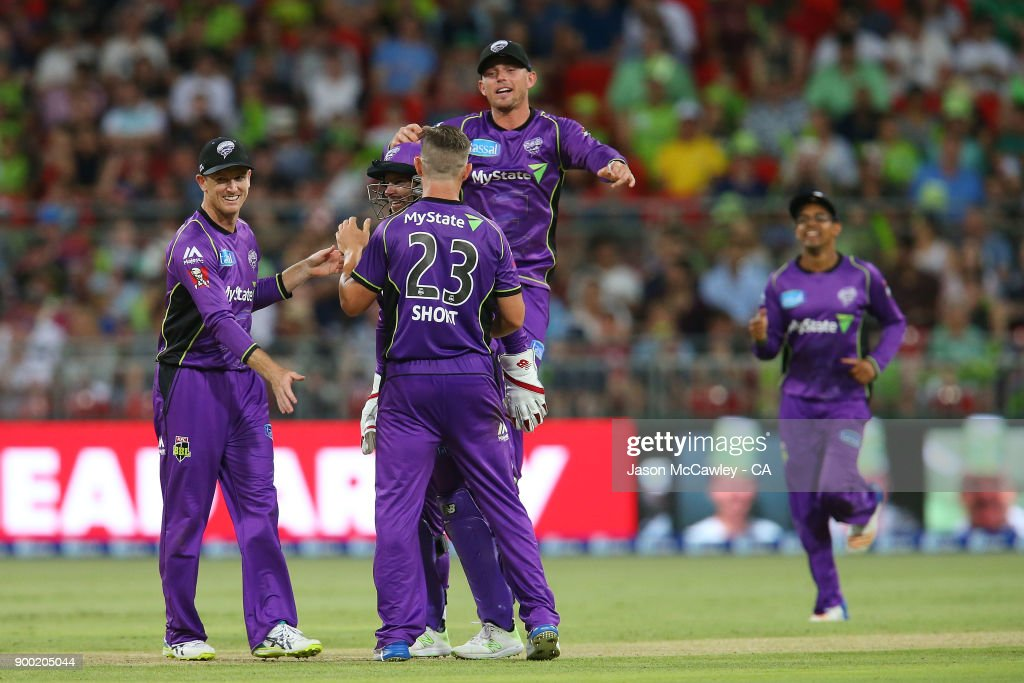 D'Arcy Short of the Hurricanes celebrates with team mates after dismissing Kurtis Patterson of the Thunder during the Big Bash League match between the Sydney Thunder and the Hobart Hurricanes at Spotless Stadium on January 1, 2018 in Sydney, Australia.