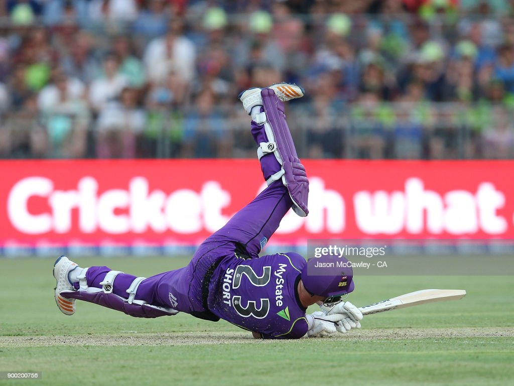 D'Arcy Short of the Hurricanes falls during the Big Bash League match between the Sydney Thunder and the Hobart Hurricanes at Spotless Stadium on January 1, 2018 in Sydney, Australia.