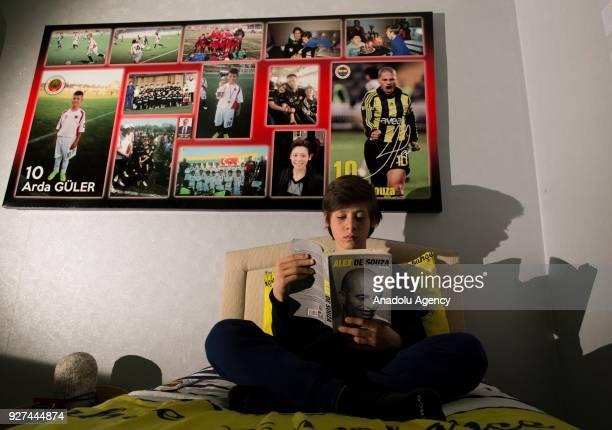 Arda Guler number 10 of the U13 team of Turkish Super Lig's Genclerbirligi football club reads book in his room in Ankara Turkey on February 20 2018...