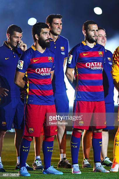 Arda Turan and Aleix Vidal of FC Barcelona look on during the team official presentation ahead of the Joan Gamper trophy match at Camp Nou on August...