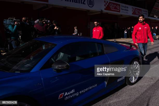 Arda Turan and Andre Gomes of FC Barcelona prepare to enjoy the Audi Driving Experience during the Audi Car handover to the players of FC Barcelona...