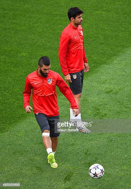 Arda Turan and Diego Costa of Club Atletico de Madrid in action during a Club Atletico de Madrid training session ahead of the UEFA Champions League...