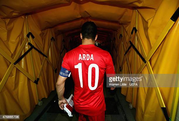 Arda Turan Captain of Turkey leads out his team during the UEFA EURO 2016 Qualifier between Kazakhstan and Turkey at the Central Stadium on June 12...