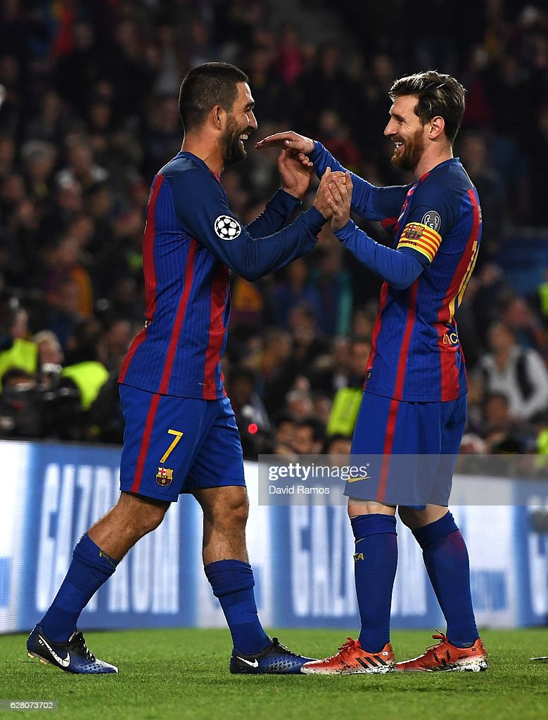 Arda Turan of Barcelona (L) celebrates scoring his sides fourth goal with Lionel Messi of Barcelona (R) during the UEFA Champions League Group C match between FC Barcelona and VfL Borussia Moenchengladbach at Camp Nou on December 6, 2016 in Barcelona, .