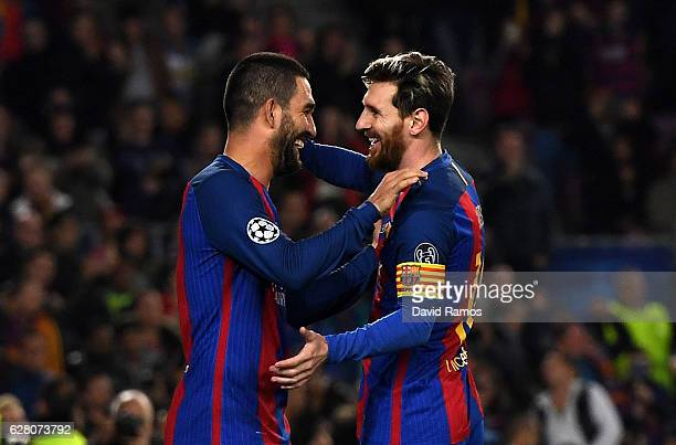 Arda Turan of Barcelona celebrates scoring his sides fourth goal with Lionel Messi of Barcelona during the UEFA Champions League Group C match...