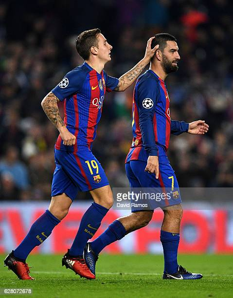 Arda Turan of Barcelona celebrates with Lucas Digne as he scores their second goal during the UEFA Champions League Group C match between FC...