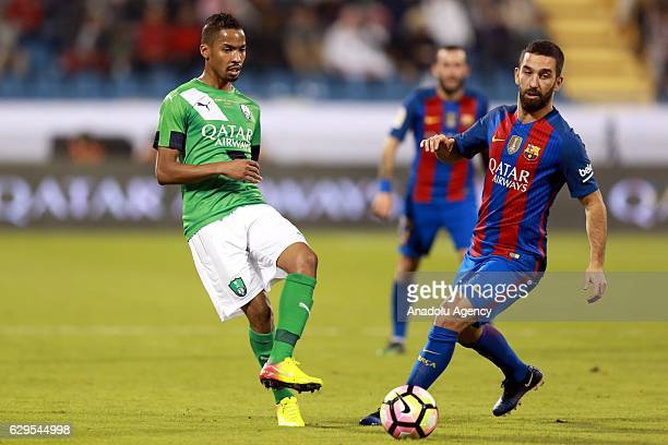 Arda Turan of Barcelona in action against Salman Al-Moasher during a friendly soccer match between Al-Ahli Saudi and Barcelona at Al-Gharrafa Stadium...