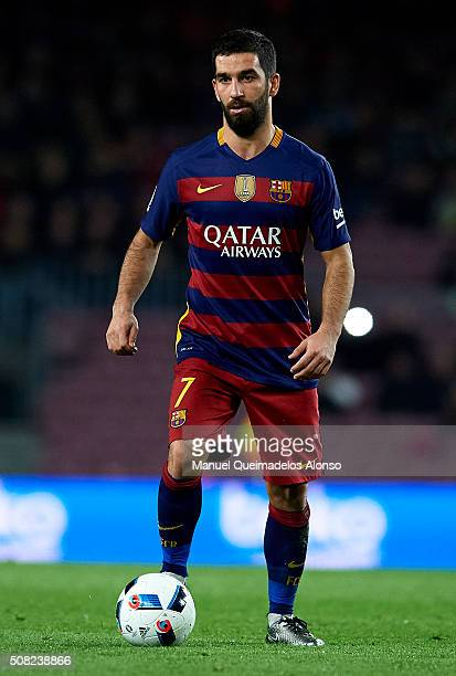 Arda Turan of Barcelona runs with the ball during the Copa del Rey Semi Final first leg match between FC Barcelona and Valencia CF at Nou Camp on...