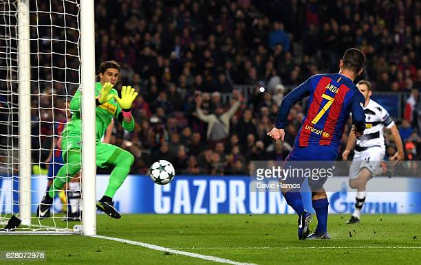 Arda Turan of Barcelona scores his sides fourth goal during the UEFA Champions League Group C match between FC Barcelona and VfL Borussia...