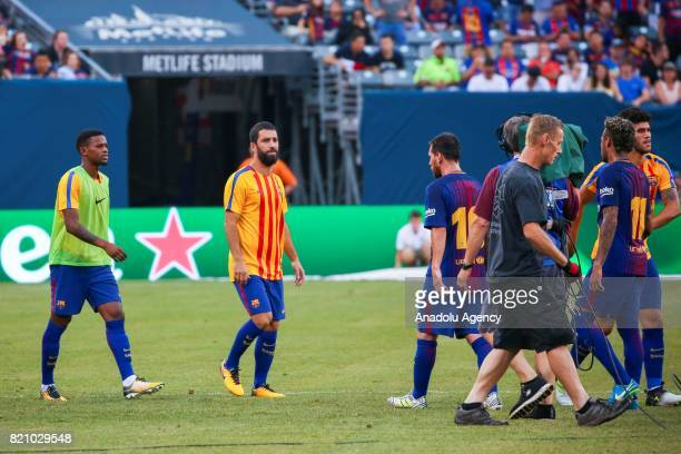 Arda Turan of Barcelona warms up ahead of the International Champions Cup 2017 friendly match between Juventus and Barcelona at Metlife Stadium in...