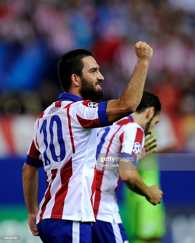 Arda Turan of Club Atletico de Madrid celebrates after scoring his team's opening goal during the UEFA Champions League Group A match between Club Atletico de Madrid and Juventus at Vicente Calderon Stadium on October 1, 2014 in Madrid, Spain.