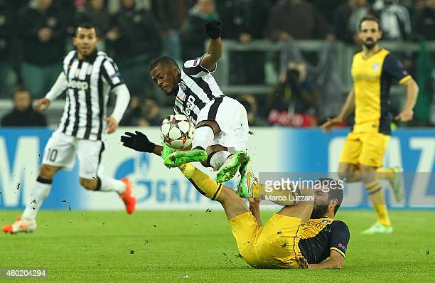 Arda Turan of Club Atletico de Madrid clashes with Patrice Evra of Juventus FC during the UEFA Champions League group A match between Juventus and...