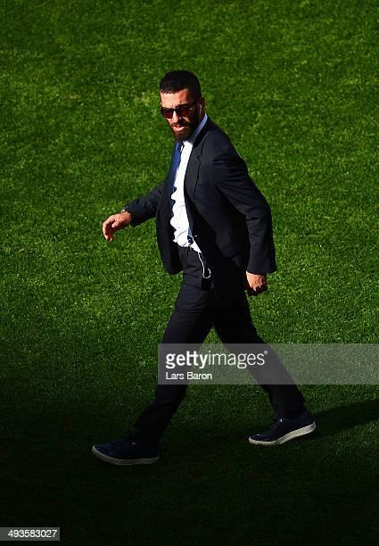 Arda Turan of Club Atletico de Madrid walks on the pitch ahead of the UEFA Champions League Final between Real Madrid and Atletico de Madrid at...