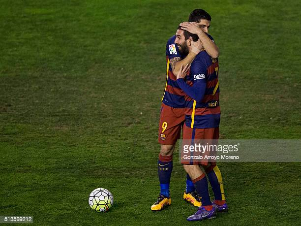 Arda Turan of FC Barcelona celebrates scoring their fifth goal with teammate Luis Suarez during the La Liga match between Rayo Vallecano de Madrid...