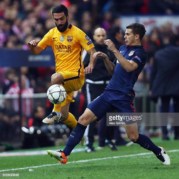 Arda Turan of FC Barcelona is challenged by Lucas Hernandez of Atletico during the UEFA Champions League Quarter Final Second Leg match between Club...