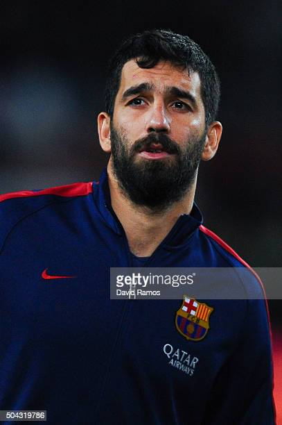 Arda Turan of FC Barcelona looks on ahead of the Copa del Rey Round of 16 first leg match between FC Barcelona and RCD Espanyol at Camp Nou on...