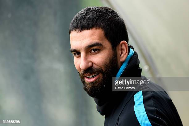 Arda Turan of FC Barcelona looks on during a training session ahead of their UEFA Champions Leage round of 16 second leg match against Arsenal FC at...