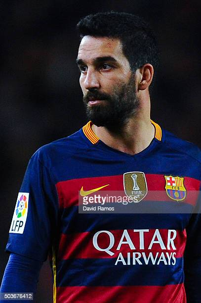 Arda Turan of FC Barcelona looks on during the Copa del Rey Round of 16 first leg match between FC Barcelona and RCD Espanyol at Camp Nou on January...