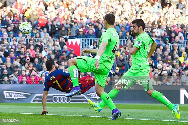 Arda Turan of FC Barcelona performs an overhead to score his team's sixth goal during the La Liga match between FC Barcelona and Getafe CF at Camp...
